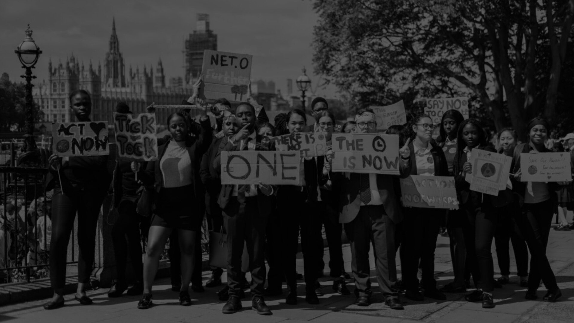 Image for Climate protestors holding up banners in front of the Houses of Parliament